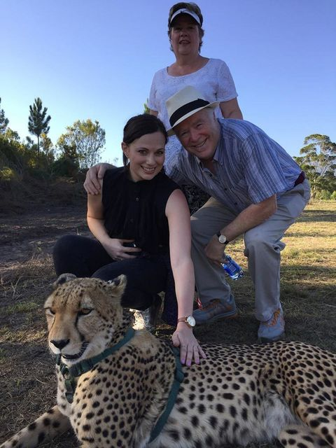 Sophie Beresiner, Beauty Director      This is me with Mum and  Dad at the Tenikwa Conservation park in Plettenberg Bay, South Africa. It's my spiritual home.