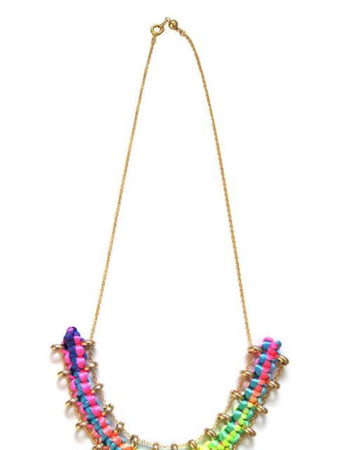 "<p><a href=""http://yuenlondon.bigcartel.com/product/rainbow-curve-necklace"">Yuen London</a> neon braid necklace, £75</p>"