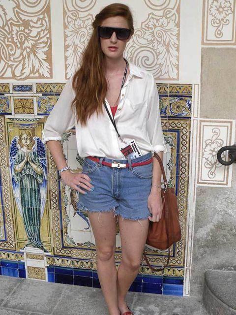 <p>Sarah, 24, Events Manager. H&M shirt, vintage shorts, shoes and bag, Crew sunglasses.</p>