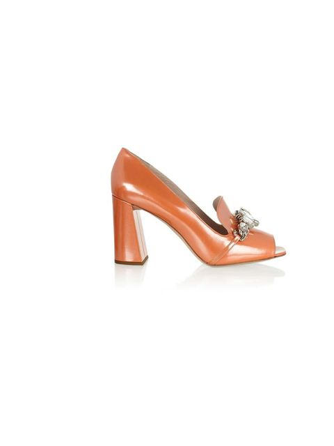 <p>A pair of heels will bring femininity to any outfit (in this case, they balance out the boyish silhouette of the sweatshirt). And this is especially true when the heels in question are a frothy concoction of peach leather and crystals... Miu Miu pumps,