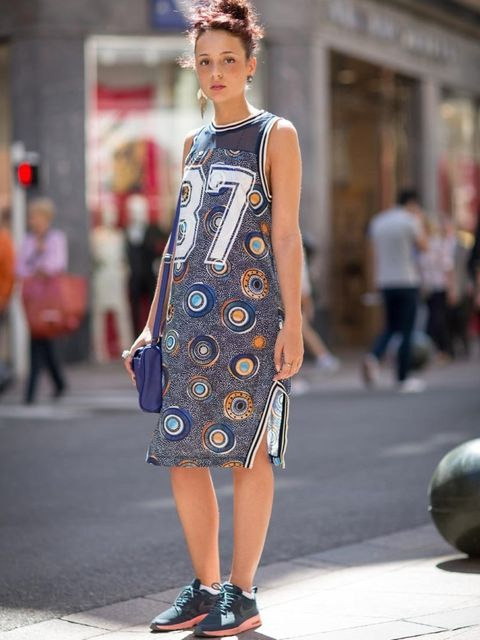 <p>Sarah wears: Zara dress, Nike trainers, Pink earrings and Zara bag</p>