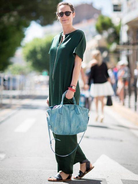 <p>Natalie wears: Cédric Charlier jumpsuit, Balenciaga sandals, Bottega Veneta sunglasses, Tod's bag</p>
