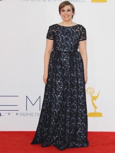 "<p>Lena Dunham wears a black lace <a href=""http://www.elleuk.com/catwalk/designer-a-z/prada/spring-summer-2013"">Prada</a> dress to the 2012 Emmy Awards in LA.</p>"