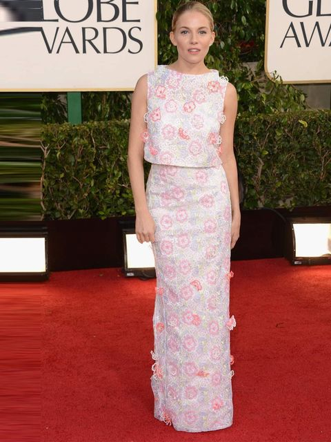 """<p><a href=""""http://www.elleuk.com/star-style/celebrity-style-files/sienna-miller"""">Sienna Miller</a> in <a href=""""http://www.elleuk.com/catwalk/designer-a-z/erdem/spring-summer-2013"""">Erdem</a> on the red carpet at the Golden Globes 2013</p>"""