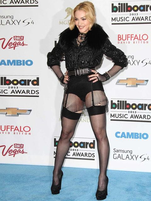 <p>Madonna stands out from the crowd wearing a custom-made Givenchy Couture outfit to the Billboard Music Awards.</p>