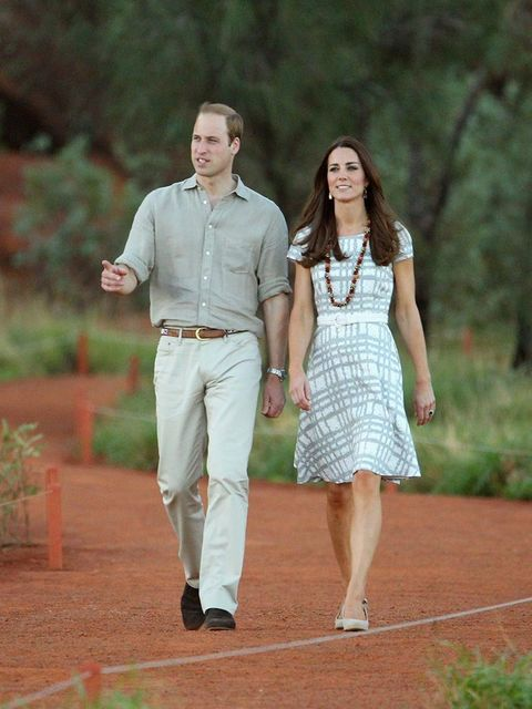 "<p>Kate - in a favourite, worn-before £35 Hobbs dress - walks down Kuniya Walk at the base of Uluru in Ayers Rock, Australia, with <a href=""http://www.elleuk.com/star-style/celebrity-style-files/prince-william-elle-man-of-the-week"">Prince William</a>.</p>"