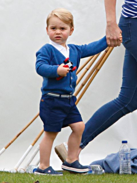 <p>Prince George, wearing a blue cardigan with a star on the back, watches dad William play at the Gigaset charity polo match in Tetbury, June 2015.</p>