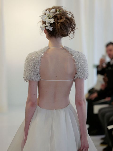 This messy up-do with white flowers blossoming from one side was pure romance at Angel Sanchez