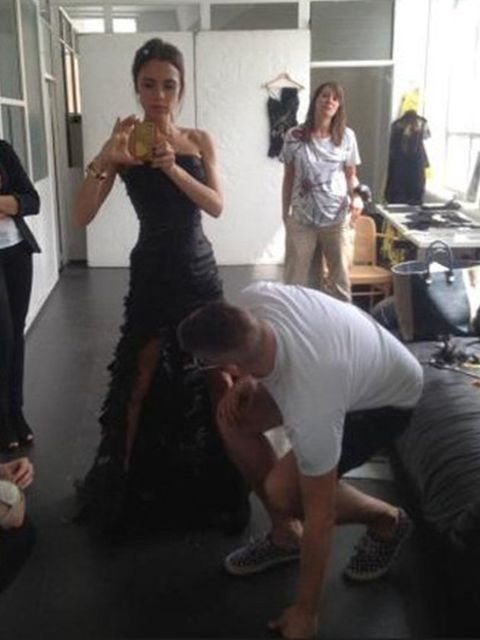 <p>Victoria Beckham in a pre-Closing Ceremony fitting with designer Giles Deacon</p>