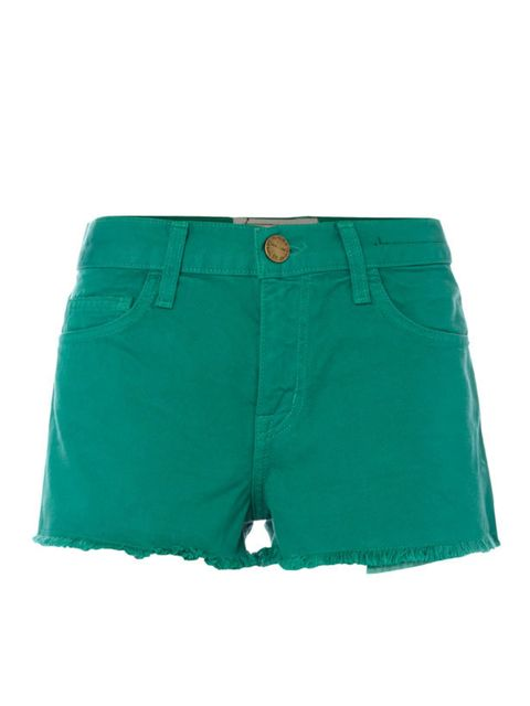 """<p>Coloured shorts aren't just for holidays. Worn with a loose shirt, brogues and a straw hat, you'll adopt a whole new take on off-duty dressing in the city… Current Elliott green denim shorts, £145, at <a href=""""http://www.donnaida.com/designers/currente"""