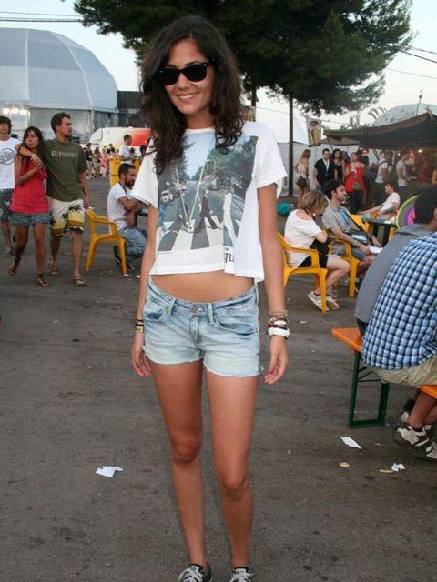 <p>Photo by Sara D'Souza.Gabriela, 21, Student. H&M t-shirt and shorts, Converse shoes, Ray Ban sunglasses.</p>