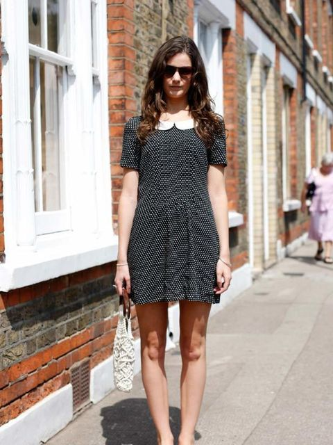 <p>Photo by Silvia Olsen @ Anthea Simms.Victoria Matthews, 22, Fashion PR. Pret-a-Portobello dress, Primark shoes, bag from car boot sale, sunglasses from Brick Lane.</p>