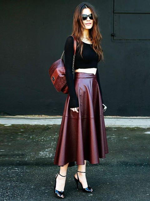 <p>A bare midriff looks ladylike when worn with a leather midi skirt and heels, Turkey.</p>