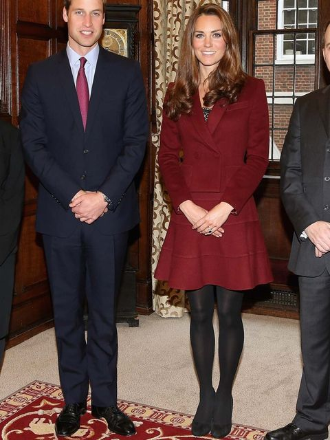 <p>Kate Middleton wears a red Paule Ka skirt suit, with LK Bennett pumps.</p>