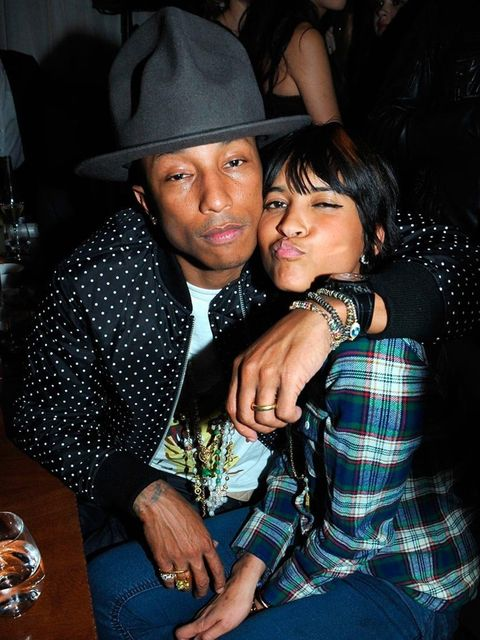 """<p><a href=""""http://www.elleuk.com/elle-style-awards/red-carpet/elle-style-awards-2014-the-winners"""">Pharrell Williams</a> and Helen Lasichanh at the BRITs 2014 Universal after-party at the Soho House pop up.</p>"""