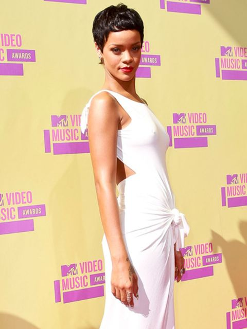 """<p><a href=""""http://www.elleuk.com/star-style/celebrity-style-files/rihanna"""">Rihanna</a> wearing a white backless draped dress at the MTV VMA Awards in Los Angeles</p>"""