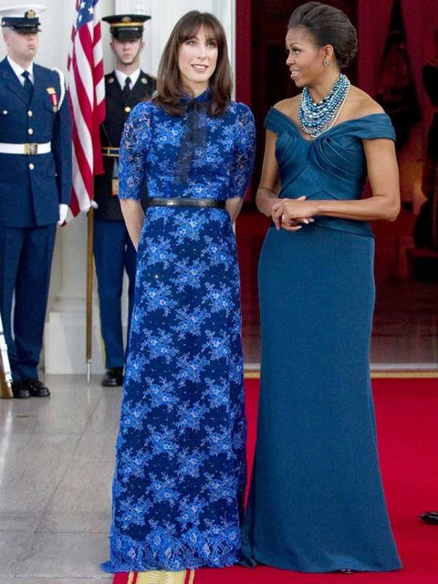 <p>Samantha Cameron wearing an Alessandra Rich column gown with Next shoes, stands next to Michelle Obama during a visit in Washington DC, February 2012.</p>