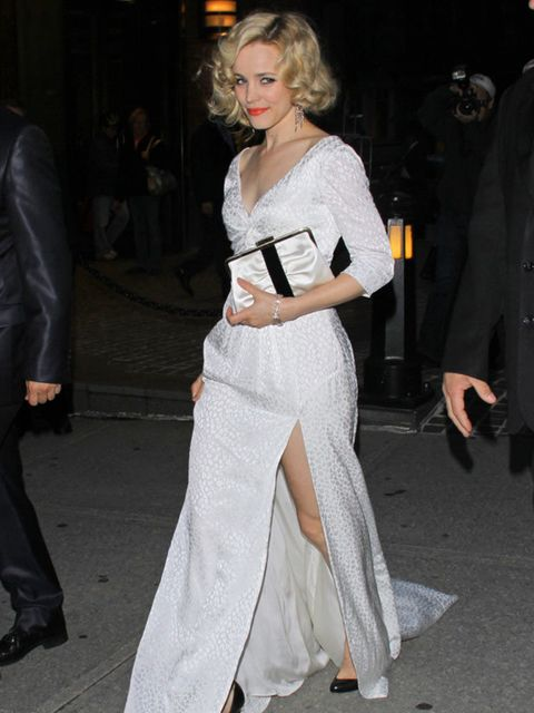 <p>Rachel McAdams for a 'Midnight in Paris' film screening in New York wears a Louis Vuitton ivory silk leopard jacquard gown, with a thigh high split, May 2011.</p>