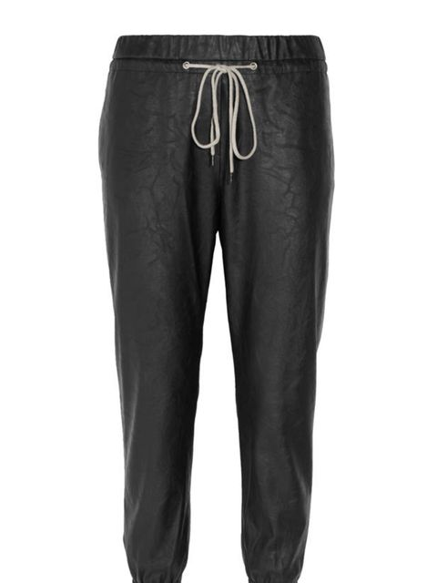 """<p>L'Agence faux leather track pants, £265, at <a href=""""http://www.net-a-porter.com/product/167004"""">Net-a-Porter</a></p>"""