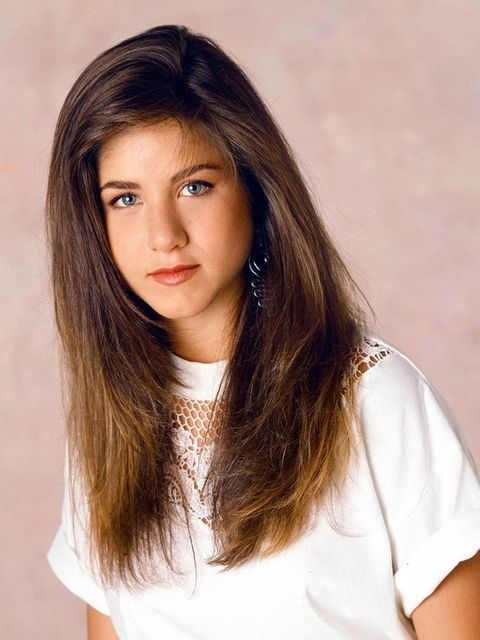<p>Where it all began: Jen flaunts thick, long hair in 1990.</p>