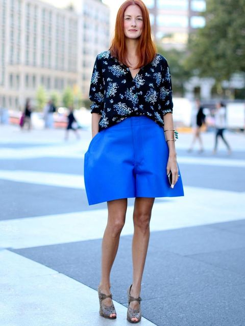 "<p>Taylor Tomasi Hill teams her structural <a href=""http://www.elleuk.com/catwalk/designer-a-z/comme-des-garcons/autumn-winter-2012"">Comme des Garcons</a> shorts with floral Equipment blouse during New York fashion week.</p>"