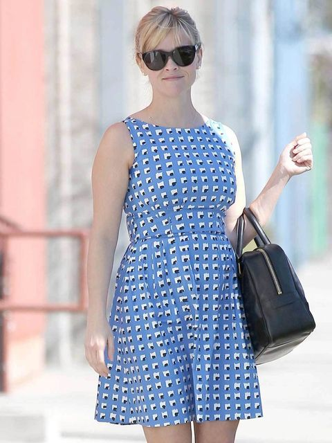 "<p><a href=""http://www.elleuk.com/star-style/celebrity-style-files/reese-witherspoon"">Reese Witherspoon</a> epitomises ladylike spring dressing in a printed skater dress, large black sunglases and chic leather bag</p>"
