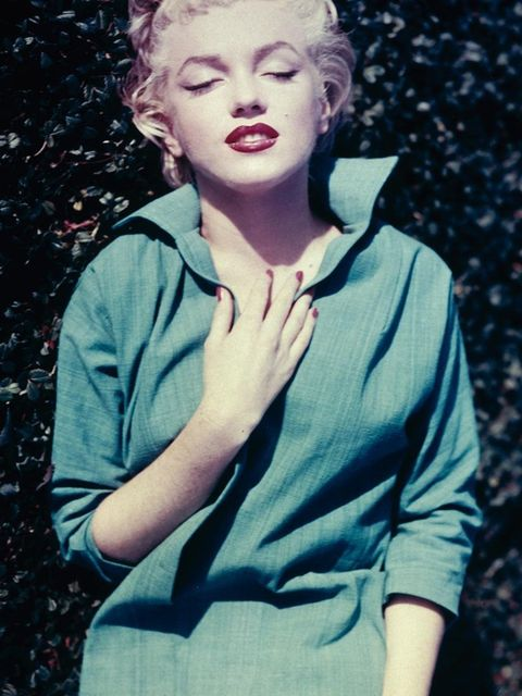 <p><strong>Marilyn Monroe, 1954</strong></p><p>Denim + red lipstick = the dream combination</p>