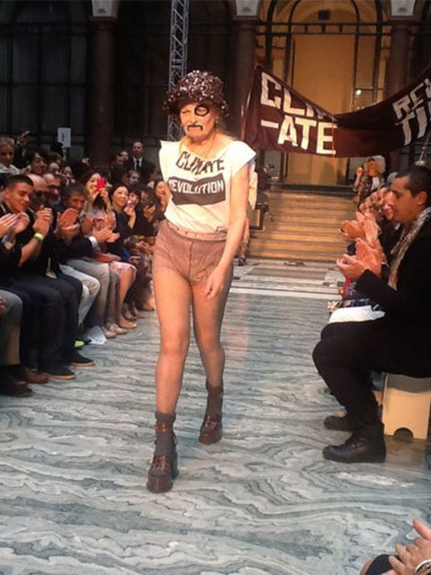 <p>The shroud is dropped to reveal Westwood's 'Climate Revolution' T-shirt</p>