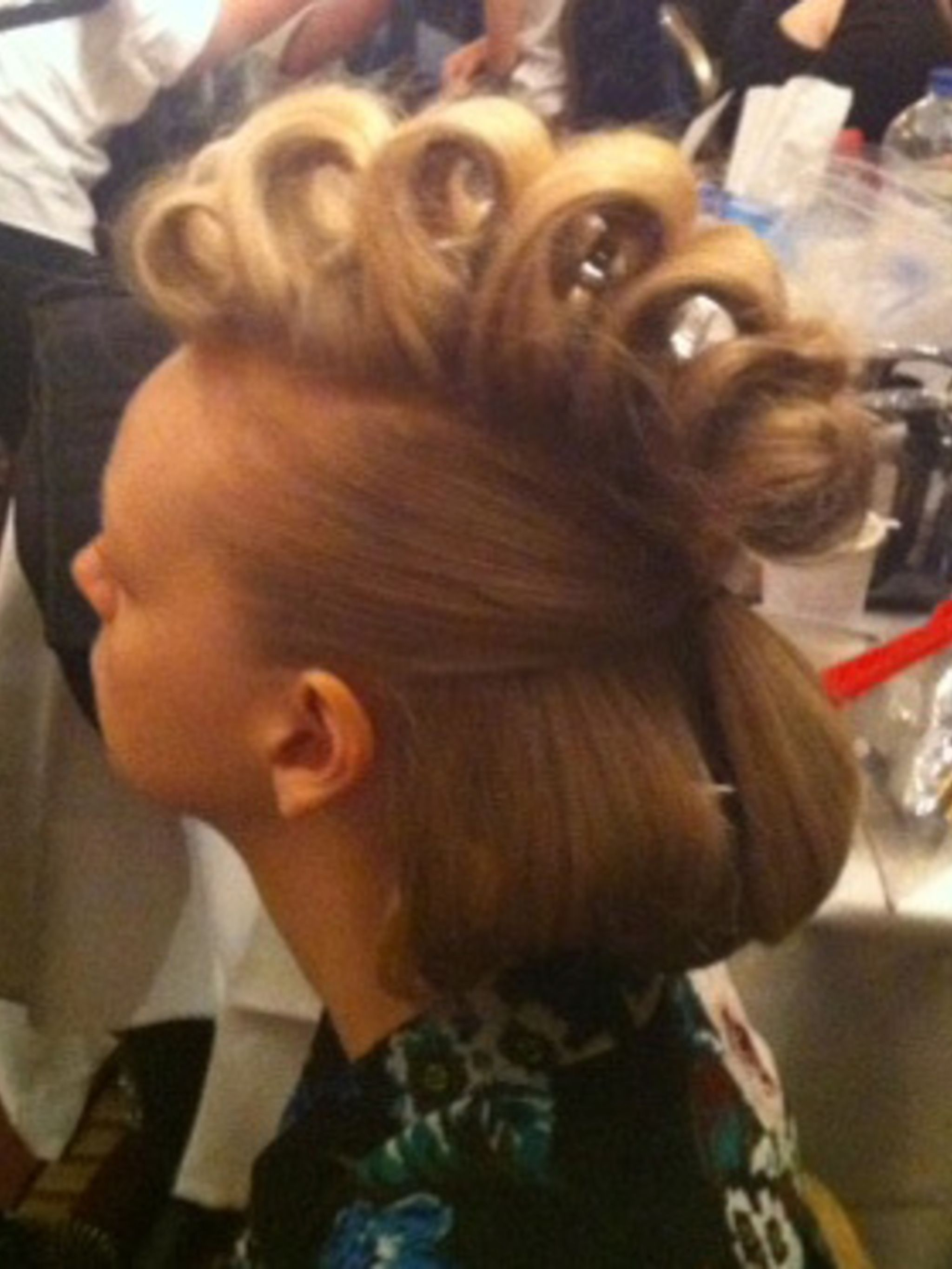 <p>A model's hair is set and ready to be finished backstage at the Teatum Jones show</p>