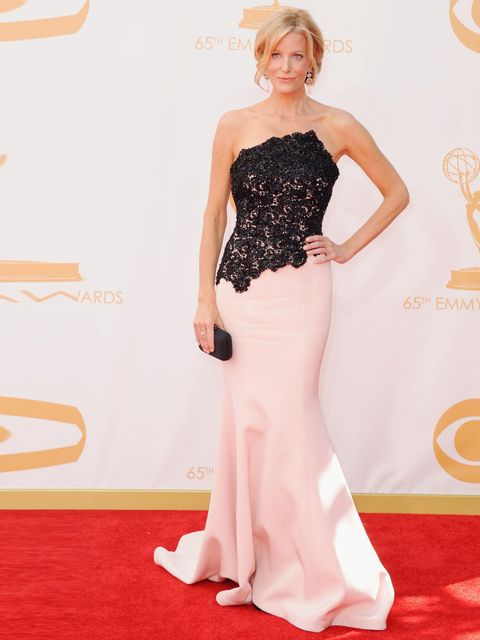 <p>Anna Gunn wearing a Romona Keveza gown with Jimmy Choo shoes at the 65th Annual Primetime Emmy Awards.</p>