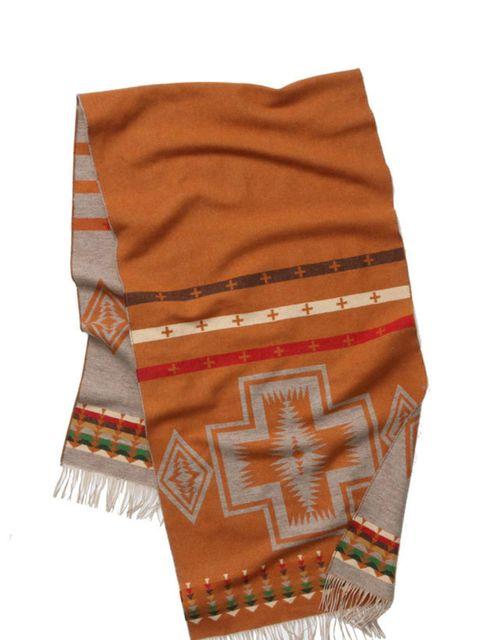 "<p>Pendleton Navajo wool scarf, £88, at <a href=""http://www.anthropologie.eu/en/uk/scarves/canyon-de-chelly-scarf/invt/7153436510001/&amp&#x3B;bklist=&amp&#x3B;colour=Orange"">Anthropologie</a></p>"