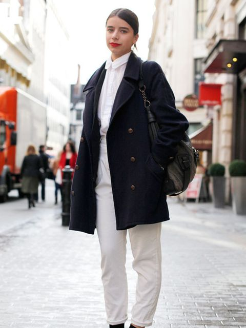 <p>Photo by Silvia Olsen.Tess Gard, 22, Sales Assistant. Vintage coat, American Apparel blazer, shirt and trousers, Aldo shoes, Country Road bag, Mac Ruby Woo lipstick.</p>