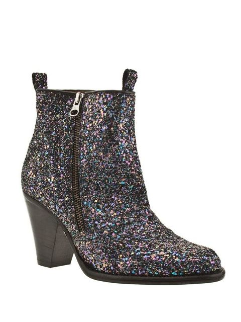 """<p>Perfect for adding edge to a simple dress, the trusty ankle boot has been given a sparkly Miu Miu-inspired makeover. Magpies: head to Schuh… <a href=""""http://www.schuh.co.uk/womens-black-and-purple-schuh-hamp-zip-ank-glitter/1431308960"""">Schuh</a> glitte"""