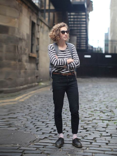 """<p>Natalie wears <a href=""""http://www.petit-bateau.co.uk/"""">Petit Bateau</a> top, vintage belt, <a href=""""http://www.topshop.com/?geoip=home%23"""">Topshop</a> jeans and <a href=""""http://uk.drmartens.com/uk/"""">Dr. Martens</a> shoes.<em>More street style galleries"""