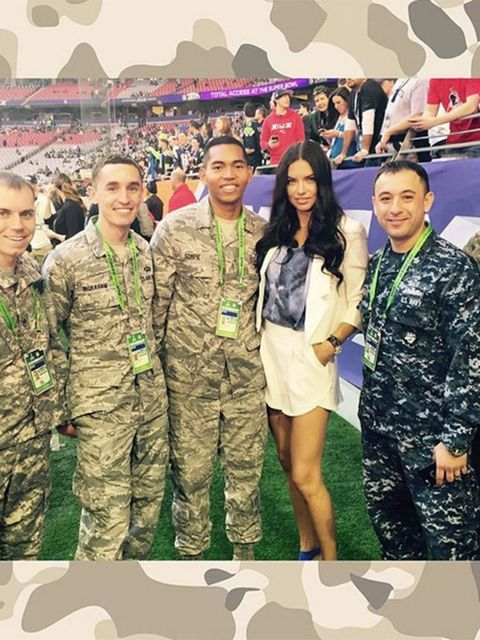 <p>Adriana Lima (@adrianalima)</p>  <p>'With the flag bearers of #superbowl good luck to both teams tonight...'</p>