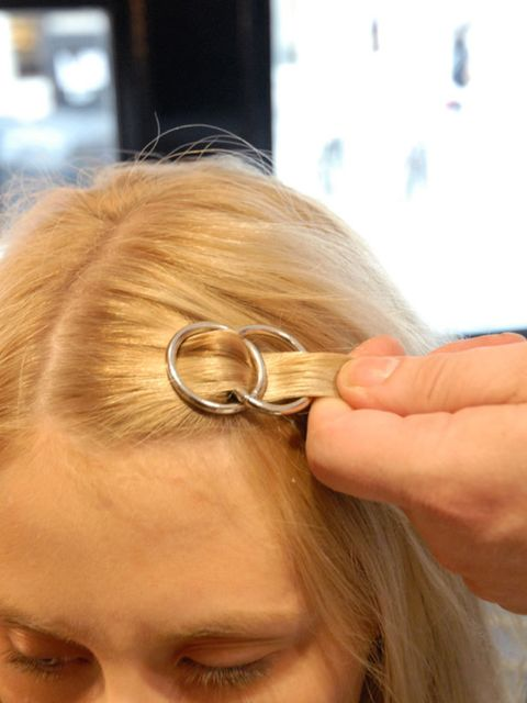 <p><strong>Step nine: </strong>The hair should be woven through your first two hoops and it should look like this.</p>
