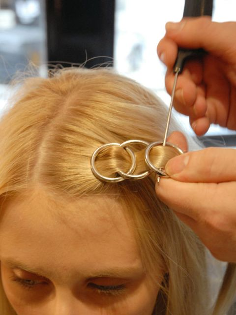 <p><strong>Step ten:</strong> Place your third hoop over the second and weave the hair through (see picture).</p>