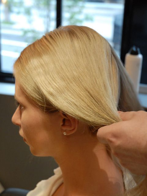 <p><strong>Step one:</strong> Work your hair into a neat centre parting with two sections, one on each side.</p>
