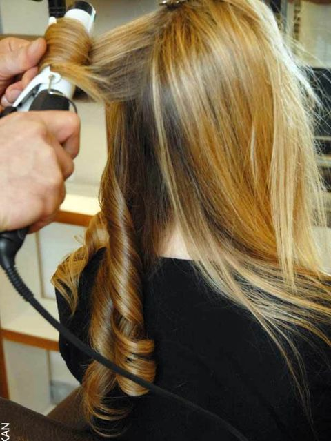 <p><strong>Step One:</strong></p><p>Tong the hair to give it volume (you can skip this step if it is naturally wavy), 'it doesn't need to be perfect, it's just to give your hairstyle a foundation' says Fadi.</p><p><strong>Top tip:</strong> lightly spritz