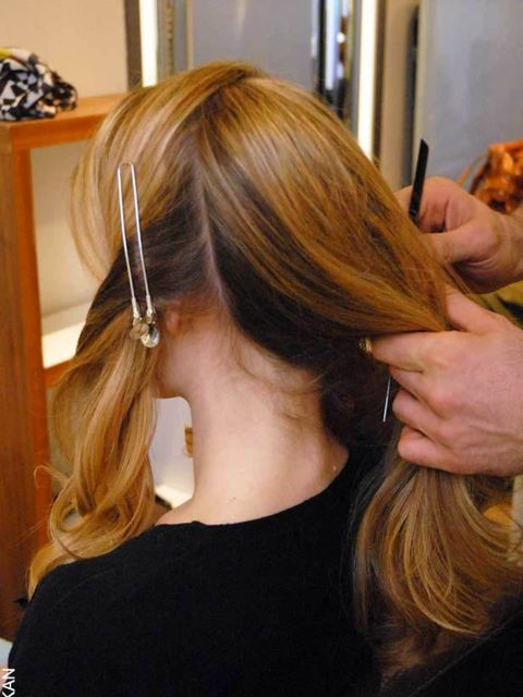 <p><strong>Step Two:</strong></p><p>Split hair into four sections using a tail comb - one section at the front, two at the sides and one at the back.</p>