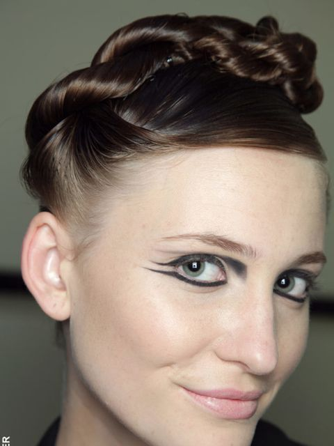 <p>An update on the bun, we saw twisted styles emerge everywhere from Paul Smith to Matthew Williamson and Antonio Berardi. Whether it was a row of tight coils at Richard Nicoll or a cluster of hair woven with coloured ribbon at Zac Posen the key to the l