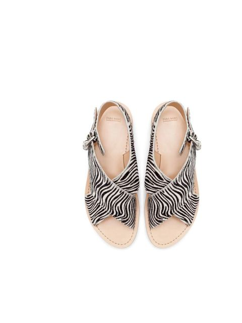 "<p>These zebra-stripe sandals will add a little punch to any outfit&#x3B; Acting Picture Editor Rossana Shokrian will be pairing hers with jeans or lightweight cotton trousers.</p><p><a href=""http://www.zara.com/uk/en/woman/shoes/zebra-pattern-crossover-sandal"