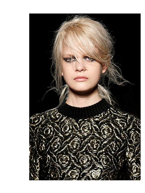 "<p>Surf Up Do</p><p><a href=""http://www.elleuk.com/beauty/beauty-notes-daily/julian-macdonald-a-gothic-fantasy"">Julian Macdonald</a> showcased a beautifully messed up 'do complete with heat-friendly ponytail to keep your neck cool, and care-free <a href="""