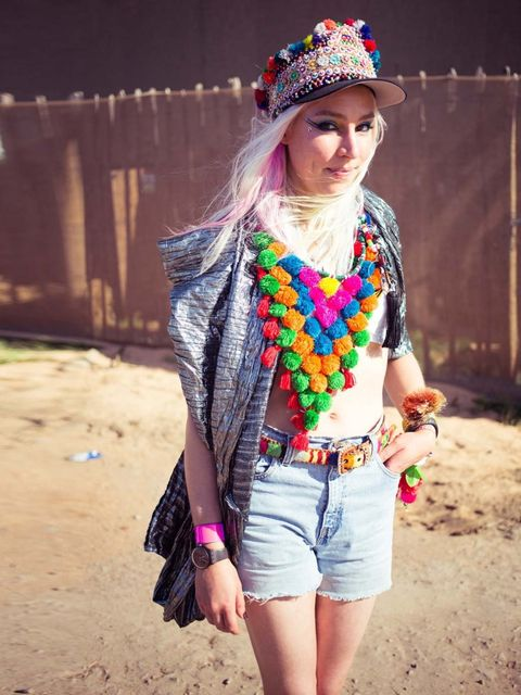<p>Fred Butler wears Fred Butler bag, vintage Levi's cut offs, homemade hat, indian necklace, vintage belt, hair colour by Fudge.</p>