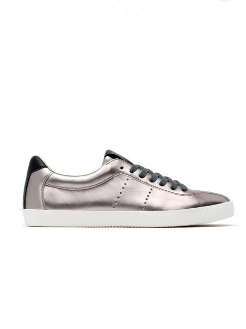 """<p><a href=""""http://www.zara.com/uk/en/woman/shoes/sneakers/shiny-plimsolls-c765518p2880519.html"""" target=""""_blank"""">Zara trainers</a>, £29</p>"""