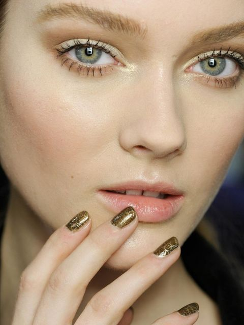 """<p>At <a href=""""http://www.elleuk.com/catwalk/designer-a-z/christian-dior/autumn-winter-2012"""">Christian Dior</a> models paired crackled gold manicures to subtle washes of gold on the eyelids. </p>"""