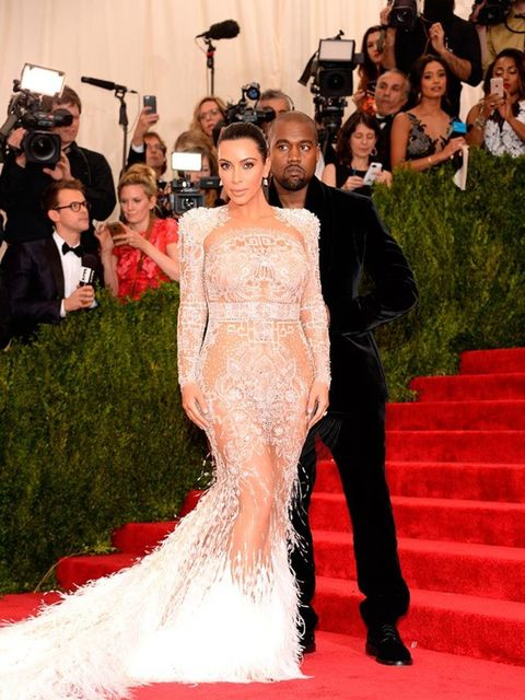 <p>Kim Kardashian and Kanye West in Roberto Cavalli by Peter Dundasattend the Met Gala, May 2015.</p>