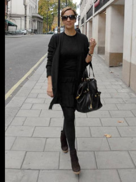 <p>Fashion Director Anne-Marie Curtis describes her look as Audrey Hepburn with a rock and roll edge. Mornings are hectic in her house so she plans her outfit the night before. She teams Gap cashmere with a Miu Miu tiered skirt and Christian Louboutin ank