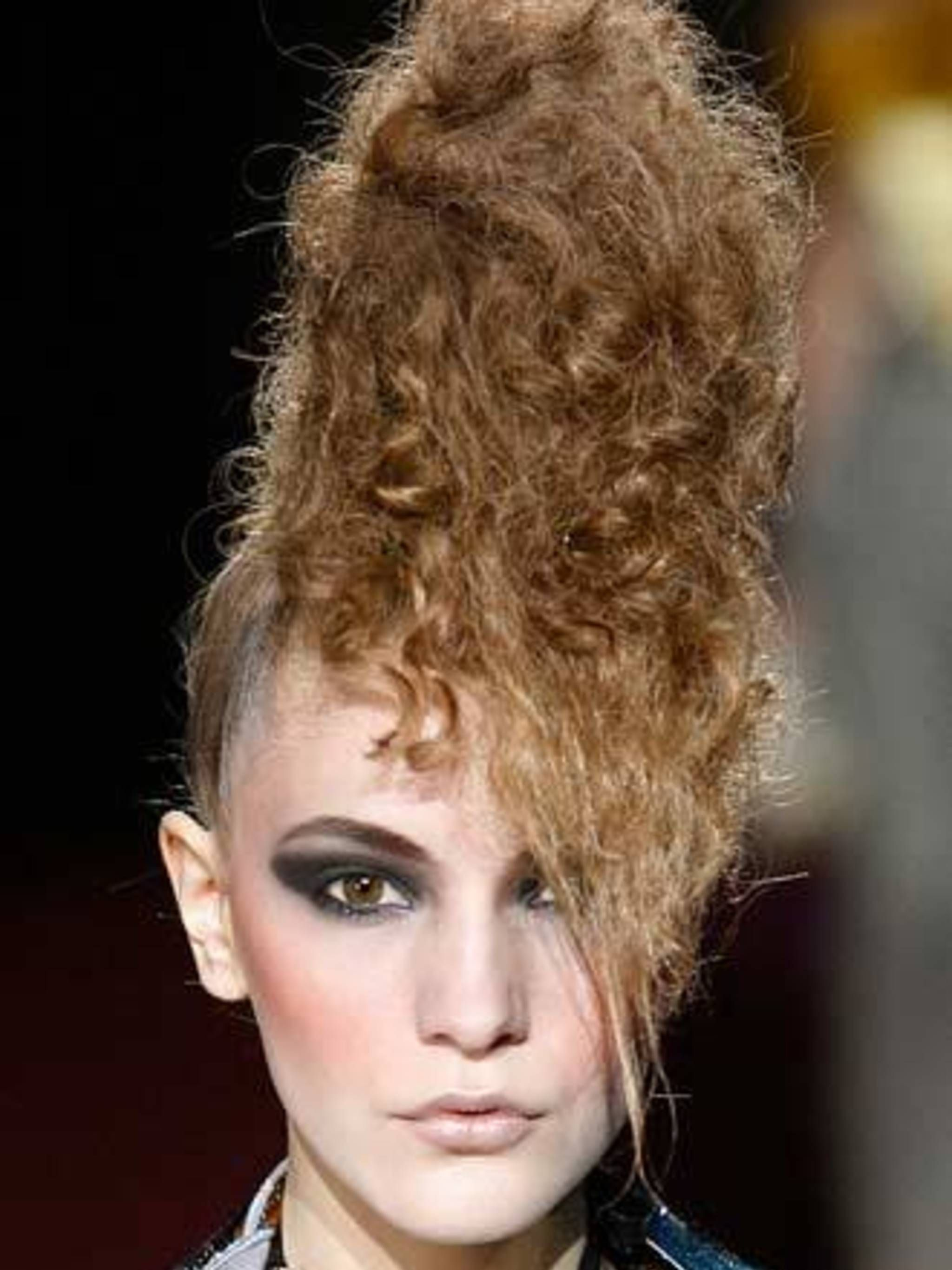 <p><strong>The Wild Bunch</strong>At hip designer Erin Fetherston hair was crimped and teased to recreate the eighties look of London's new romantics. For Marc Jacobs too, hairstylist Guido took a trip back to the bad taste decade, creating a variety of a