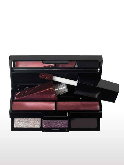 <p>Evening functions are a pre-requisite of fashion week so thank god for this mini kit that includes three eyeshadows for a no-brainer smoky look, as well as plum-toned glosses for instant glamour. Its dinky size means it comes everywhere with me while t